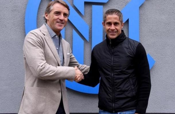 Sylvinho e Roberto Mancini